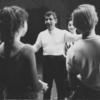 Leonard Bernstein (with Carol Lawrence in background) instructing cast during rehearsal for West Side Story.