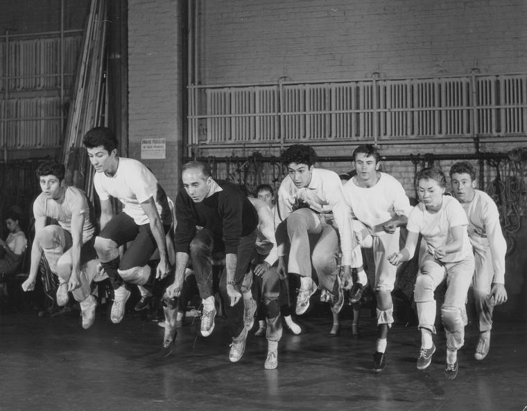"Jerome Robbins leading dancers (including Tony Mordente and George Chakiris) rehearsing ""Cool"" number for West Side Story."