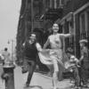 Larry Kert and Carol Lawrence running down the street in promotional photo for West Side Story.