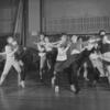 "Jerome Robbins (at left) rehearsing cast for ""Dance at the Gym"" number in West Side Story."