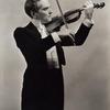 Guy Robertson as Johann Strauss, Jr. (on violin) in The Great Waltz.