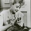 Gypsy Rose Lee feeding a puppy