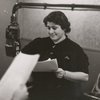 Gertrude Berg at microphone during radio broadcast of The Goldbergs
