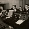 Adolph Deutsch, Mervyn LeRoy, Larry Hart, unidentified man, and Richard Rodgers in Warner Brothers Studio, Hollywood
