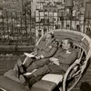 Lorenz Hart and Richard Rodgers in lounge chair on rooftop