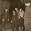 Richard Rodgers and Lorenz Hart with others viewing art designs on floor.