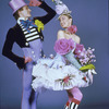 Two dancers from American Ballet Theatre production of Gaite Parisienne posing for promotional shot in colorful and extravagant costumes designed by French haute couturier Designer Christian Lacroix.
