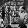 Choreographer Jerome Robbins (R) speaking with unidentified ballerina (L).