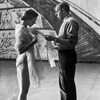 (L-R): Dancer Barbara Milberg speaking with choreographer Jerome Robbins about her costume.