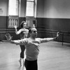 Choreographer Jerome Robbins leading ballerina in rehearsal.