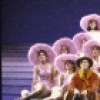"Actor Keith Carradine (C) with cast in a scene from the Broadway musical ""The Will Rogers Follies."" (New York)"