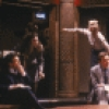 """Actress Julianne Moore (rear R) with cast in a scene from the New York Shakespeare Festival's production of the play """"Serious Money."""" (New York)"""