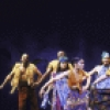 "Actors (L-R) Keith Tyrone, James Stovall (rear), Monique Cintron, Vanita Harbour, Natalie Venetia Belcon, Carol Dennis (C), Gerry McIntyre, Sheila Gibbs & Miles Watson in a scene fr. the National tour of the Broadway musical ""Once On This Island."" (Chicago)"