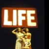 "Actresses (L-R) Alice Haining, Melinda Eades and Kerrianne Spellman standing below LIFE magazine logo in a scene from the Off-Broadway play ""The Cover of Life."" (New York)"