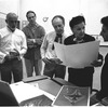 "New York City Ballet rehearsal room, Jerome Robbins, Edward Bigelow, George Balanchine and costumer Barbara Karinska looking at Nicholas Benois' sketches for ""Theme and variations"", choreography by George Balanchine (New York)"