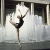 New York City Ballet dancer Patricia Neary poses in front of fountain at the newly built State Theater at Lincoln Center (New York)