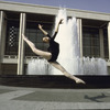 New York City Ballet dancer Patricia Neary leaps in front of fountain at the newly built State Theater at Lincoln Center (New York)