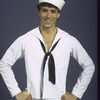 """New York City Ballet dancer Christopher d'Amboise in a studio portrait costumed for """"Fancy Free"""" choreography by Jerome Robbins (New York)"""