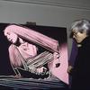Artist Andy Warhol with painting of choreographer Martha Graham (after Barbara Morgan photographs)