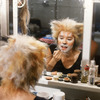 "Actress Christine Langer applying make up before going onstage in musical ""Cats."""