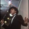 Producer Joseph Papp singing at nightclub appearance at The Ballroom (New York)