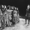 "A man addressing a group of women in a scene from the Circle In The Square production of the play ""The Bacchae"""
