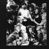 "Director Trevor Nunn surrounded by cast members in costume from the Broadway production of the musical ""Cats."""