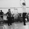 Choreographer Alvin Ailey (L) working with a dancer in the studio.