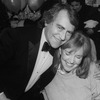 "Producer Joseph Papp hugging actress Anne Meara at the opening night party for the NY Shakespeare Festival production of the play ""Cafe Crown""."