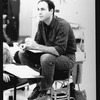 """Director/playwright James Lapine sitting on a stool during a rehearsal for the Broadway production of the musical """"Sunday In The Park With George.""""."""