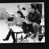 """Director/playwright James Lapine (R) sitting on a stool during a rehearsal for the Broadway production of the musical """"Sunday In The Park With George.""""."""
