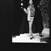 """Director Geoffrey Holder wearing a black cape on the set of the Broadway production of the musical """"The Wiz.""""."""