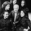 """Director Peter Brook (C) with five singers who alternate as Carmen in the Broadway production of the opera """"La Tragedie De Carmen."""" (clockwise frombottom L Cynthia Clarey, Eva Saurova, Helene Delavault, Emily Golden and Patricia Schuman)"""