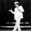 "Actress Liza Minnelli in a white suit and fedora performing a number from the Broadway production of the musical ""The Act"""