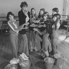 """Actress Dorothy Loudon blowing a whistle as she is surrounded by orphan girls incl. Andrea McArdle (L) as Little Orphan Annie during a rehearsal for the Broadway production of the musical """"Annie.""""."""