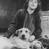 "Actress Allison Smith as Little Orphan Annie with Sandy the dog in a scene from the Broadway production of the musical ""Annie.""."