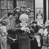 """Actress Alice Ghostley surrounded by taunting orphans in a scene from the Broadway production of the musical """"Annie.""""."""