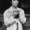 """Actress Amy Irving clutching a book in a scene from the Circle In The Square production of the play """"Heartbreak House""""."""