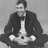 "Comic Jerry Lewis sitting crosslegged in a promo shot for the pre-Broadway tour of the musical revue ""Hellzapoppin""."