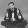 """Comic Jerry Lewis sitting crosslegged in a promo shot for the pre-Broadway tour of the musical revue """"Hellzapoppin""""."""
