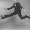 """Comic Jerry Lewis mugging while flying in a promo shot for the pre-Broadway tour of the musical revue """"Hellzapoppin""""."""