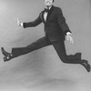 "Comic Jerry Lewis mugging while flying in a promo shot for the pre-Broadway tour of the musical revue ""Hellzapoppin""."