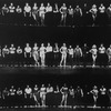 "Original cast of the Broadway musical ""A Chorus Line"" standing on the line in various states of lighting."