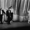 "New York City Ballet production of ""Movements for Piano and Orchestra"" with Jacques d'Amboise and Suzanne Farrell taking a bow in front of the curtain with conductor Robert Irving and pianist Gordon Boelzner, choreography by George Balanchine (New York)"