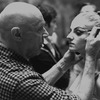 "New York City Ballet production of ""Illuminations"" Michael Arshansky backstage adjusts Sara Leland's makeup, choreography by Frederick Ashton (New York)"