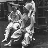 "New York City Ballet production of ""Illuminations"" with dancers backstage sewing shoes, choreography by Frederick Ashton (New York)"